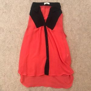 Sheer orange and black sleeveless blouse